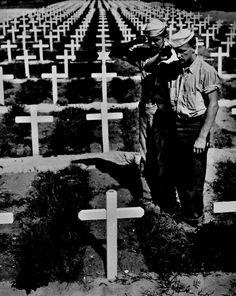 Memorial Day Honoring the fallen through photos 1945 With row upon row of crosses marking graves in an American cemetery, two members of the US Coast Guard stand and salute in silent homage to their fallen comrade on the Ryukyu Islands. American Cemetery, Dramatic Photos, Foto Real, National Archives, American Soldiers, Military History, Ww2 History, Family History, History Images