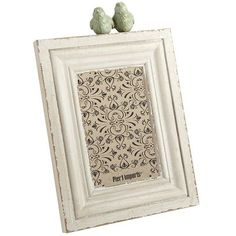 Perched Birds Frame ~  A bird in the hand is worth two in the bush. But two birds on a frame? That's priceless. This charming heirloom-style desk frame is comprised of classic stacked molding and a matched pair of antiqued wooden lovebirds perched up top.