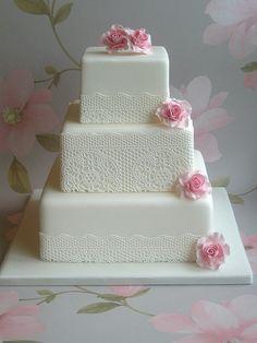 Simple lace doily style wedding cake. Beautiful.