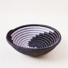 Navy and Silver Plateau Basket : Navy and Light Blue Plateau Basket. Made of handwoven sweetgrass & sisal,locally sourced natural fibers which are hand-dyed. A loop on the back is available for hanging. Indego African products are designed in NYC and handmade in Africa using traditional techniques, local materials, and genuine artisanal skill. They partner with artisan women in Rwanda and Ghana to create a range of handmade products, all with a creative voice of playfulness, an appreciation…