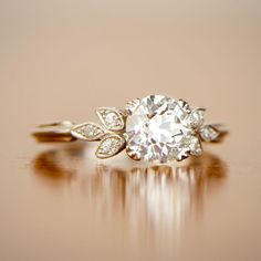 A floral motif vintage style engagement ring. Estate Diamond Jewelry Collection.