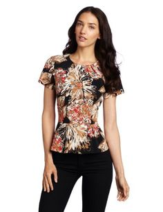 Trina Turk Women's Femme Fatale Top Trina Turk. $109.00. Dry Clean Only. polyester. This satin Trina Turk top has a pleated neckline, short sleeves, waist peplum, and a concealed back zipper. Body is fully lined.