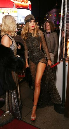 Abbey Clancy certainly did just that when she put on a very cheeky display in a revealing sheer dress speckled with gold for her 1920s-themed 30th birthday party at the Rah Rah Room night club.
