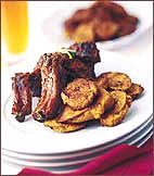 Juicy pork ribs, with a fruity guava-garlic glaze, are hugely popular at Jimmy's in Bronx, New York. Guava paste is available at Latin American markets and many supermarkets.