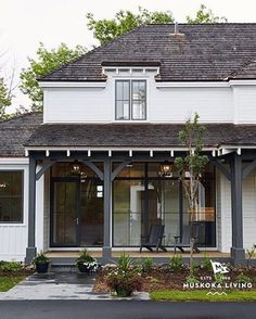 What do you think of the white house and the dark trim? I'm like ! (From @muskokalivinginteriors)