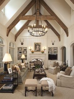 Great Room with timber trusses designed by TS Adams Studio Architects.