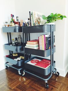 Two ikea raskog carts house our bar, our favorite cookbooks, and my home office supplies. #ikeahack #barcart #storage