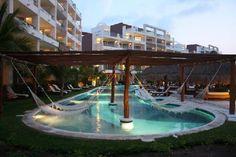 Excellence Playa Mujeres: Resort - hammocks over pool