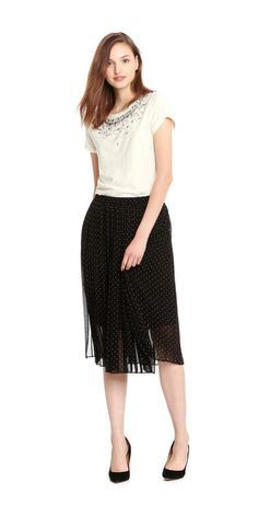 Print Pleat Midi Skirt from Joe Fresh. We put a chic spin on the skirt this season with knife pleats, polka dots, and a midi length.  Only $49.