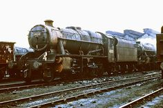 48012. So typical of the end of steam - it's February 1968,and a filthy Stanier 8F stands at Edge Hill shed,in Liverpool. Photo by curly42