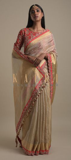 Gold Beige Saree In Zari Kota Silk With Red Scallop Border And Tassels On The Pallu Online - Kalki Fashion Kota Silk Saree, Kota Sarees, Bandhani Saree, Lehenga Blouse, Silk Lehenga, Saree Dress, Silk Sarees, Sari, Latest Indian Saree