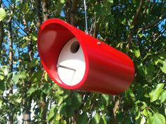 Made from 4 PVC pipe and wood, this birdhouse will make a fine home for your feathered friends. Bright red body with almond accent. The front