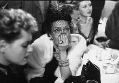 Gloria Swanson awaiting the results of the Academy Award for Best Actress at a cafe on West 52nd Street, New York