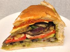 Veggie sandwich with grilled eggplant, zucchini, portabella mushroom, red onion, red pepper, provolone and pesto