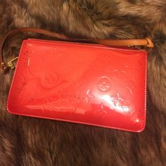 100%authentic Louis Vuitton sunset Blvd red vernis Patent leather clutch/purce/bag w/ strap.  I'm  selling this red Louis Vuitton bag.  It was purchased brand new at Louis Vuitton in NYC for over $1,000.  Guaranteed authentic.  However, it has some damage - black markings on both sides as shown in the pictures. Thanks for your interest. Date code V I 1011 Louis Vuitton Bags Clutches & Wristlets