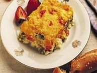 Your vegetarian friends will love it when you bake this omelet, an updated version of the ham and sausage stratas.