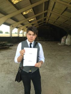 James Doughty holding the script for 'The Farm'.