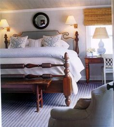 This is a relaxed and comfortable looking bedroom using an American empire low post bed with an upholstered headboard.