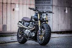 A bullet-ridden BMW from Sicily, a stunning Honda cafe racer from GT-Moto, and Ducati Scrambler tweaked an an Italian eyewear company. Triumph Cafe Racer, Triumph Scrambler, Triumph Bonneville T100, Cafe Racer Bikes, Cafe Racer Motorcycle, Moto Bike, Cool Motorcycles, Motorcycle Design, Triumph Motorcycles