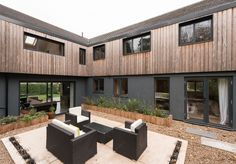 On the market: Kate Stoddart-converted modernist property in Ewshot, near Farnham, Surrey - WowHaus House Cladding, Timber Cladding, Exterior Cladding, Facade House, Building Design, Building A House, Farnham Surrey, 1960s House, Industrial Office Design