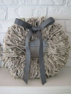 DIY:  How to Make a Linen Wreath - using a wire coat hanger, pliers and strips of linen.  This would also make the perfect neutral base for any seasonal or holiday wreath - via Beautiful Nest
