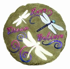 This stepping stone has the words Love, Dream & Believe. and the dragonflies on the stone glow in the dark! Decorative Garden Stones, Painted Rocks, Hand Painted, Dragonfly Wall Art, Believe, Glow, Garden Stepping Stones, Flower Cart, Love Dream