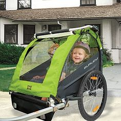 Burley Honey Bee Bike Trailer and Stroller!  Burley®, a bike trailer leader, is famous for its tough safety standards and testing. It converts easily from bike trailer to stroller! Lightweight and easy to push/pull, and it's comfortable for kids to ride in, The stroller handle is height-adjustable (what a plus!).
