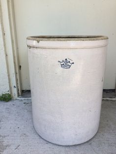 This is a 15 gallon vintage ivory stoneware crock that looks great in almost any decor! The crock has a blue crown with 15 in the center and U.S.A.  Use the crock as an umbrella stand, a planter or add it with other crocks for a lovely collection of crocks! The uses for this crock are endless! 21 1/2H x 17 D  The crock has several holes drilled in the bottom. There is a chip on the rim and hairline crack.      Inv0000015