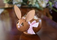 """Introducing Ashley, our new bunny candy dish. This adorable caramel colored bunny has a cute pink nose that's complemented by the pink bow around her neck. She is hand-crafted from an approximately 4"""" diameter and 5 1/2"""" long gourd."""