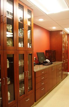 Love this for a pharmacy right outside exam rooms. Looks great and you can see what you have. Locks would be nice though.  Northpaws Veterinary Center | Hospital Design