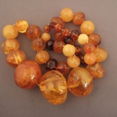 """Amber, Baltic area Description : This amber (36 beads) necklace is worn for their prophylactic virtues or more generaly because it represents prosperity and gives protection to the wearer....The real amber like this one is a fossilized resina from pin tree ( more than 100 millions year old) mostly coming from Baltic sea... Weight:239,5gr Length:27,55 inch For sale in my shop in Brussels and also on my website www.halter-ethnic.com under the item """"My Lucky Finds"""""""