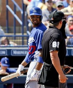 Los Angeles Dodgers' Matt Kemp disputes the called third strike by home plate umpire Clint Fagan in the third inning of a spring training baseball game