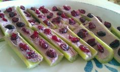 "Lady bugs on a log! O Organic Celery (cut in half), Ocean Spray's original dried cranberries (3-4 per ""log""), Lucerne's mixer berry flavor whipped cream cheese spread (enough to fill each ""log""). 10-15 Calories each.  Yummy snack for all ages. :)"