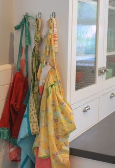 coloful aprons on a white backdrop via pleated poppy