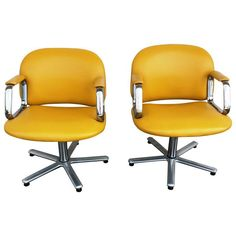 Mid-Century Yellow Upholstered Chair - A Pair - $900 Est. Retail - $450 on Chairish.com. swivel desk chairs