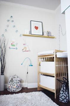 Stokke Care Changing Table in natural featured in French-inspired baby girl nursery space via URBAN CRUSING Liapela.com