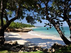 Unlike the ones in Varadero, the beaches in Baracoa feel / Playa Maguana, Cuba  a few steps from the beach where Columbus stranded in 1492. About 20 km from Baracoa.completely secluded.