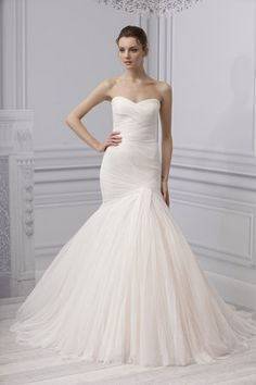 There's a sweetness about Monique Lhuillier's 'Forever' dress. We love the dynamic simplicity of the bodice and the lightness of the full skirt... all in pristine balance.