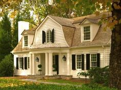 GORGEOUS! This is like my alltime dream house.....  old white house and black shutters :)