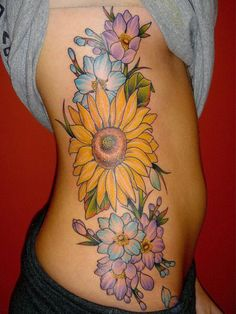 Sun Wrap Tattoos | sunflower tattoo pictures girls with sun flower tattoo on side