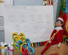 I was walking past the writing center, and guess who I saw there all ready for tomorrow? Our little elf Cuddles..... Looks like he wrote a quick note to the kids and even drew their picture. They are going to be so thrilled with his art work.... He is soooo talented. :)