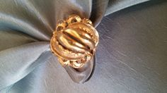 One ladies free form style 18k yellow gold ring.