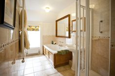 Rose Cottage luxury en-suite (walk in power showers, separate double ended baths, under floor heating, heated towel rails & fitted hair dryers) bathrobes, slippers and toiletries.