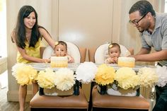 Cute high chair banners / pom poms at a Honeybee Twin 1st Birthday Party via Kara's Party Ideas