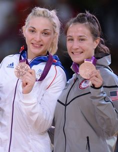 Good job Marti!!!  Bronze medalists France's Automne Pavia (L) and United States' Marti Malloy pose on the podium of the women's -57kg judo contest.