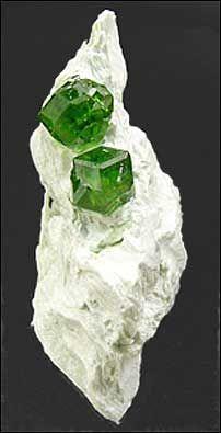 Andradite variety demantoid, 3.1 cm, from the Jeffrey mine, Asbestos, Quebec.