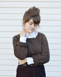 sweater over blouse and bun