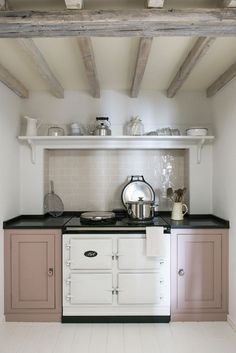 AGA Country Kitchen in white and pink - don't want these colours but like the small recess and shelf above.