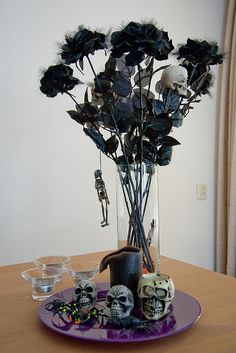 A good tip we use for our Halloween party is to get cheap plastic flowers and spray paint them black.  And I save old dead flowers from the summer to do the same thing.  And we also go to the cemetery where they place all the old wreaths to decorate too.  Spoooooky!