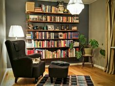 Redecorated library. Oak wood floor, chandelier, DIY shelves.